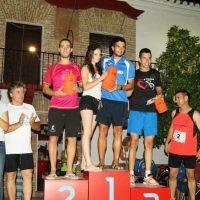 El atleta del Trotasierra Pedro Cuadrado y la atleta del C.A. Porcuna Yolanda Muñoz vencen en la Carrera urbana de Lopera